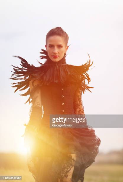 glamorous goth woman and woodland with fall colors - women in suspenders stock pictures, royalty-free photos & images