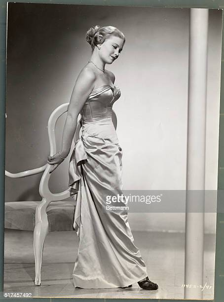 Glamorous is the word for the pink slipper satin Victorian evening dress work by Joan Caulfield Paramount actress whom you'll see in Dear Wife The...