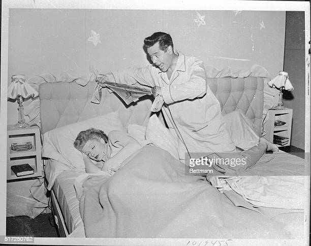 Glamorous Lucille Ball and husband Desi Arnaz play the husbandand wife team on CBSTV's domestic comedy series I Love Lucy Miss Ball plays a stage...