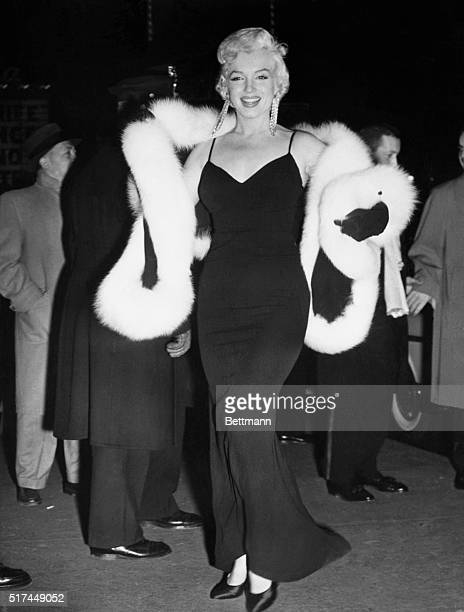 Glamorous Marilyn Monroe in all her splendor arrives at the Astor Theater for the world premiere of the film The Rose Tattoo The proceeds of...