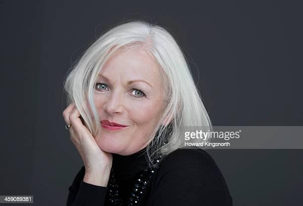 glamorous mature woman holding hair