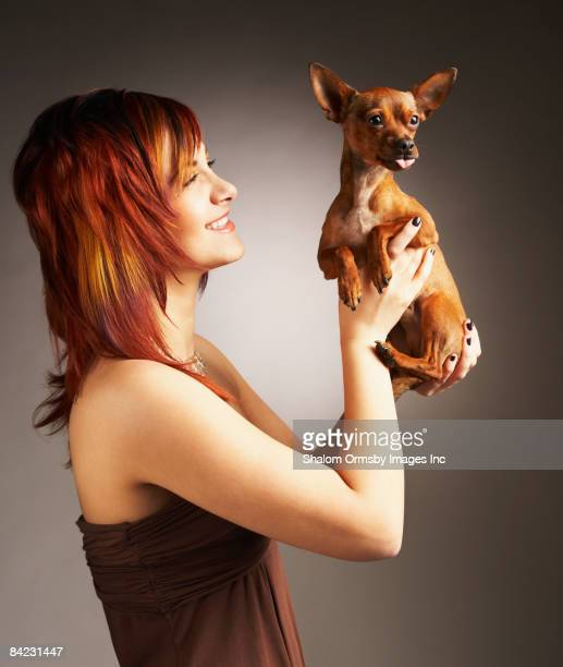 Glamorous Middle Eastern woman holding dog