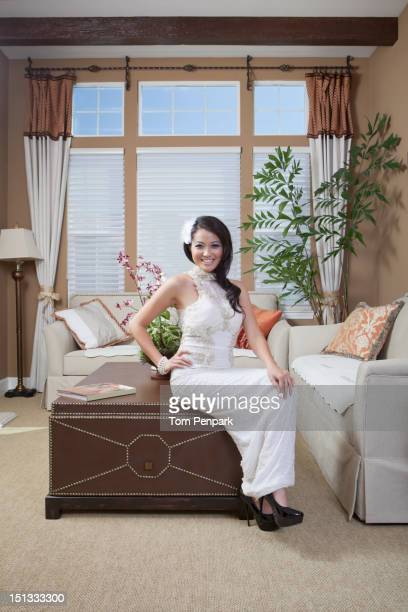 Glamorous mixed race woman in living room
