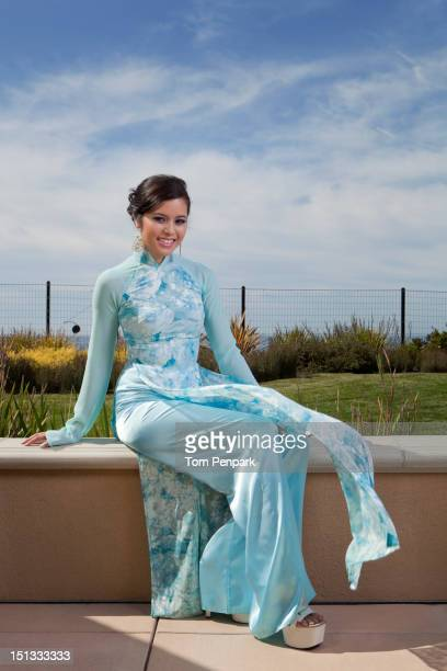 Glamorous mixed race woman sitting outdoors