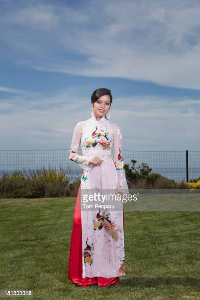 Glamorous mixed race woman standing in field