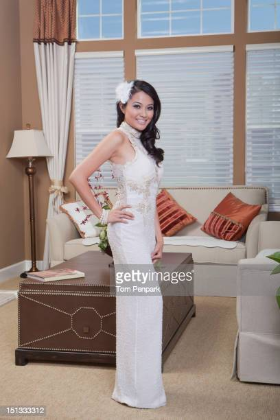 Glamorous mixed race woman standing in living room