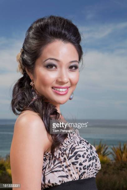 Glamorous mixed race woman standing outdoors