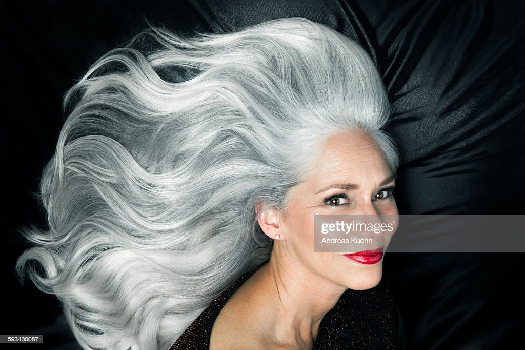 Glamorous portrait of a woman with long gray hair. : Photo