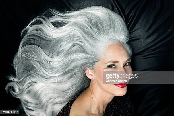 Glamorous portrait of a woman with long gray hair.