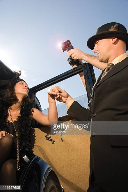 glamorous retro movie star with bodyguard and paparazzi - flapper stock photos and pictures