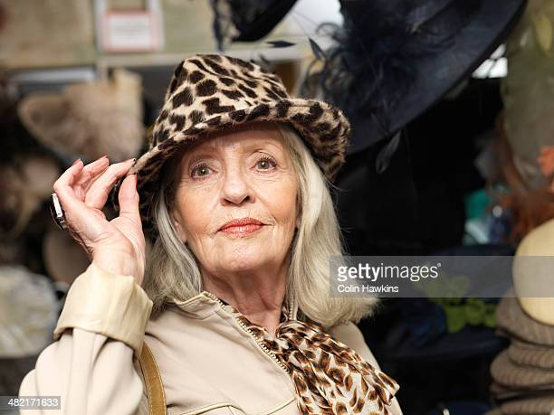 Glamorous senior woman in leopardskin hat