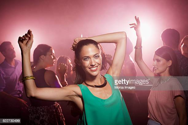 Glamorous woman dancing at nightclub