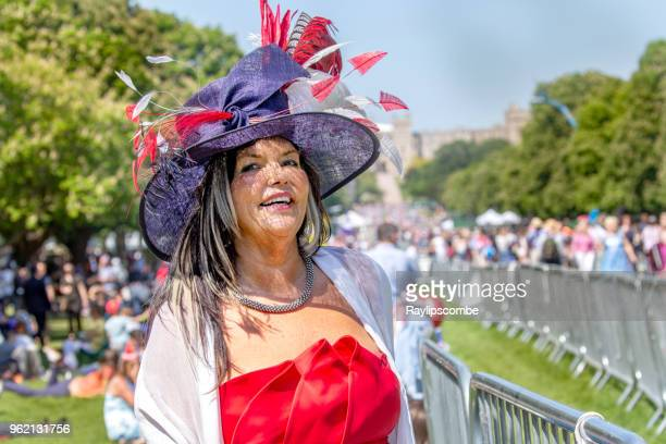 glamorous woman in an elaborate feather hat stood in windsor great park's 'long walk' to celebrate the marriage of meghan markle and prince harry - meghan stock photos and pictures