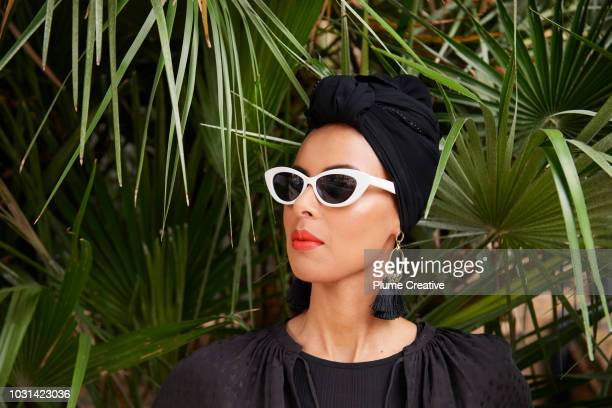 glamorous woman in sunglasses in tropical scene - modest clothing stock pictures, royalty-free photos & images