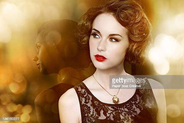 glamorous woman leaning against her own reflection - evening gown stock pictures, royalty-free photos & images