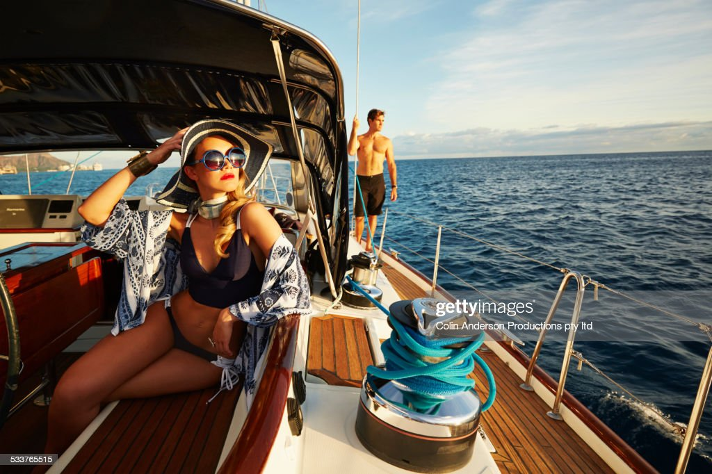 Glamorous woman relaxing on yacht deck : Foto stock