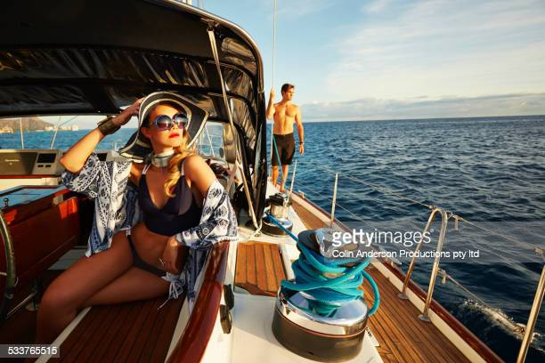 Glamorous woman relaxing on yacht deck