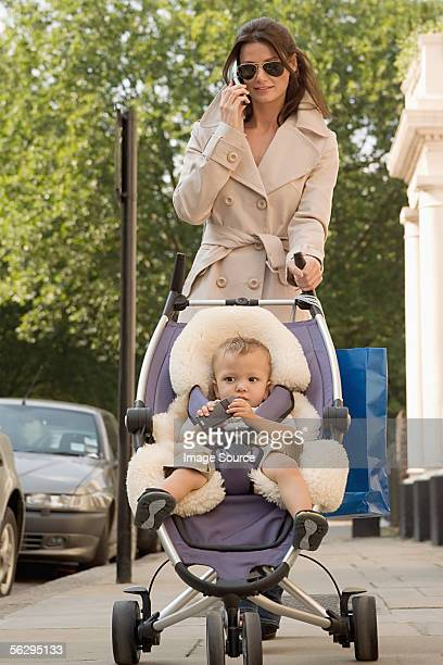 Glamorous woman walking with her baby