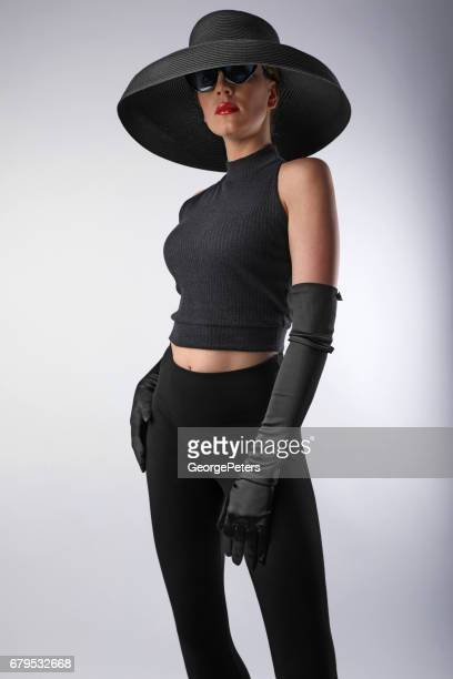 glamorous woman with attitude and wearing vintage fashion - femme fatale stock photos and pictures