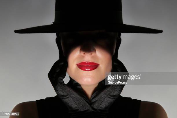 glamorous woman with dark, film noir style lighting - evening glove stock pictures, royalty-free photos & images