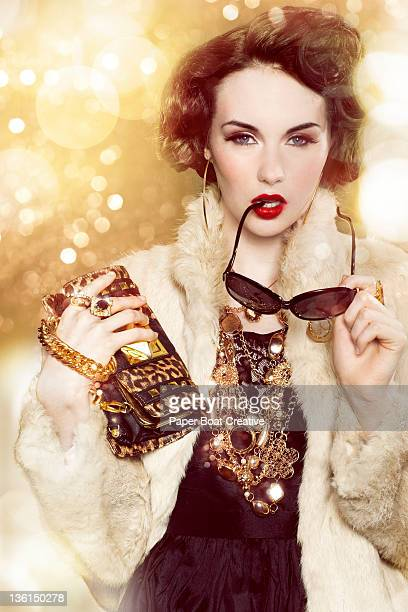 glamorous woman with gold chains and fur coat - pochette borsetta foto e immagini stock