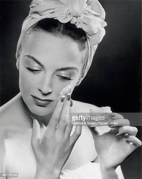 Glamour fashion shot of a model applying �Valcrema skin youth� to her face