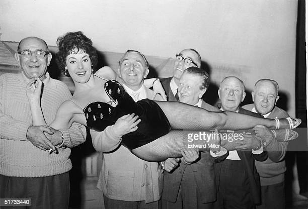 Glamour girl Anne 'The Shape' Hart rehearsing with the Crazy Gang for their new show 'Clown Jewels' at Victoria Palace London 12th February 1959 Her...