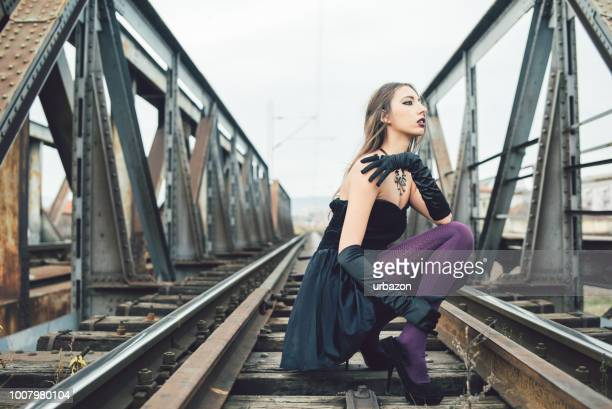glamour goth on rail bridge - purple dress stock pictures, royalty-free photos & images