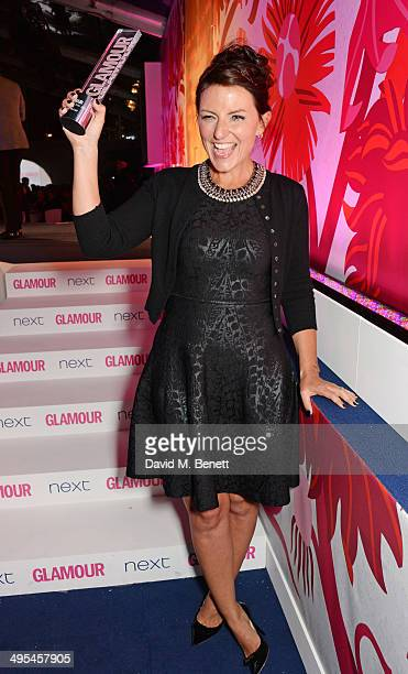 Glamour Hera Award winner Davina McCall poses at the Glamour Women of the Year Awards in Berkeley Square Gardens on June 3 2014 in London England