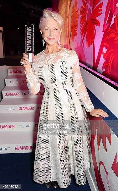 Glamour Icon award winner Dame Helen Mirren pose at the Glamour Women of the Year Awards in Berkeley Square Gardens on June 3 2014 in London England