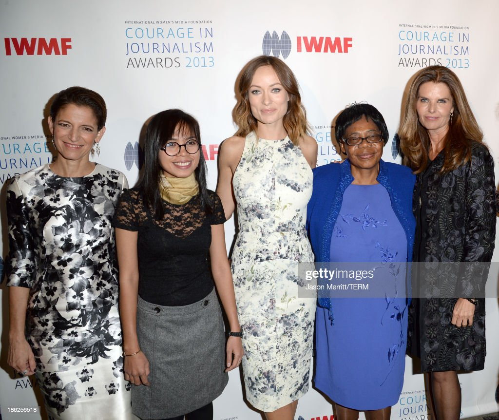 Glamour Magazine Editor in Chief Cindi Leive, honoree Bopha Phorn, actress Olivia Wilde, Lifetime Achievement winner Edna Machirori, and journalist Maria Shriver attend the International Women's Media Foundation's 2013 Courage in Journalism Awards at the Beverly Hills Hotel on October 29, 2013 in Beverly Hills, California.