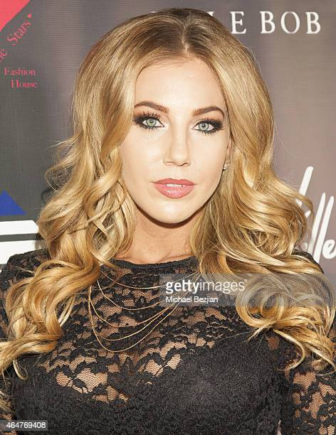Glamour Model Emily Phelps attends Caroline Burt DJs At Victoria Fuller's The Beauty Code Art Show at The Redbury Hotel on February 25 2015 in...