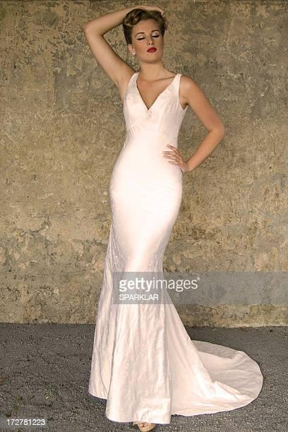 glamour model in white gown - long dress stock pictures, royalty-free photos & images