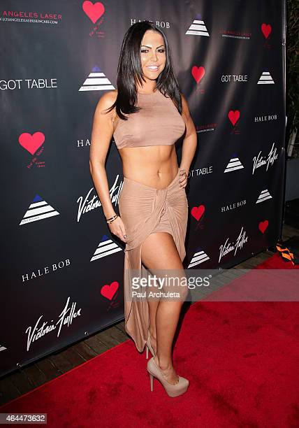 Glamour Model Jessica Cribbon attends Victoria Fuller's 'The Beauty Code Art Show' at The Redbury Hotel on February 25 2015 in Hollywood California