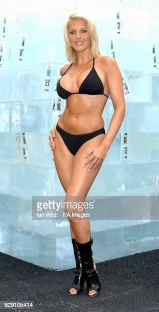 Glamour model Jo Hicks poses for photographers in front of a 10tonnes ice cube at Broadgate Arena near London's Liverpool Street Station The 25...