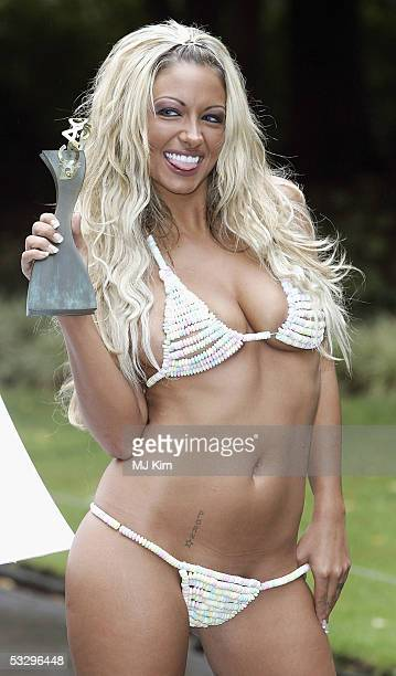Glamour model Jodie Marsh poses in a candy gstring and candy bra to launch the Gift Of The Year Awards at The Savoy on July 28 2005 in London England...