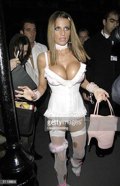 Glamour model Jordan arrives at her 25th birthday party at Embassy London on May 25 2003
