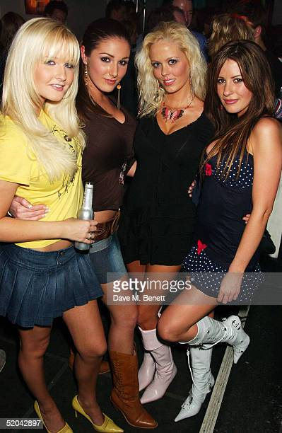 Glamour models Michelle Marsh and Lucy Pinder with friends attend the 1st Birthday party for Nuts Magazine at Trap Wardour Street on January 20 2005...