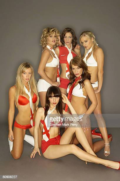 Glamour modelsturned singers Elle Taylor Sarah Jane Clark Kayleigh Pearson Lauren Pope Lucy Layton and DJ Sassy of new girl band Glam'R'Us pose ahead...