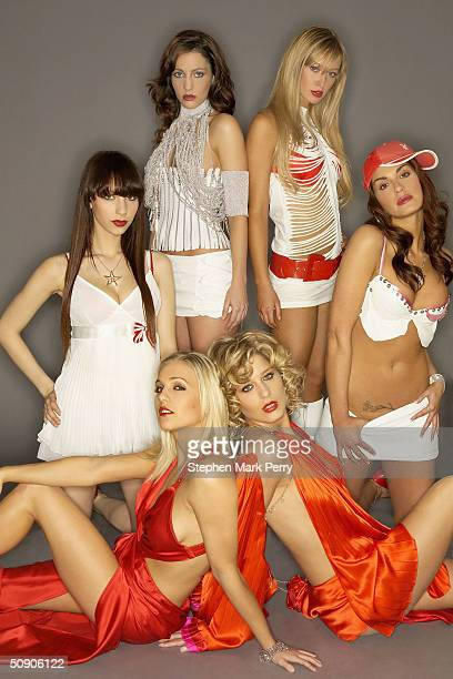 Glamour modelsturned singers Kayleigh Pearson Elle Taylor Lucy Layton DJ Sassy Sarah Jane Clark and Lauren Pope of new girl band Glam'R'Us pose ahead...
