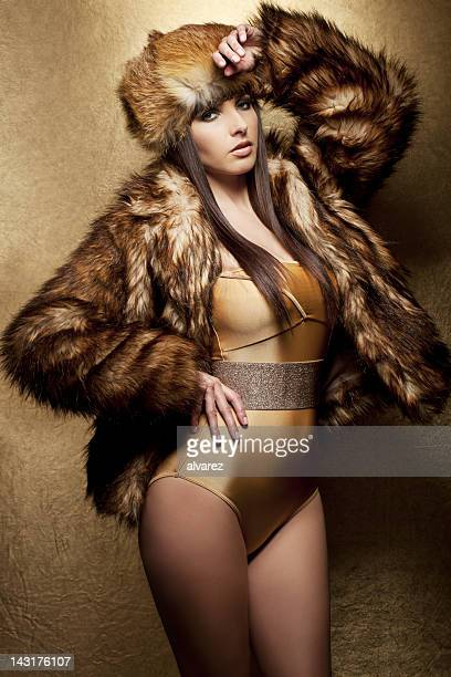 glamour party girl - fur hat stock photos and pictures