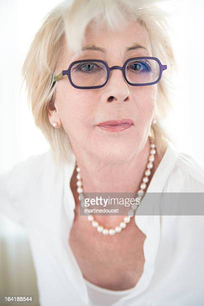 Glamour portrait of real woman in her seventies.