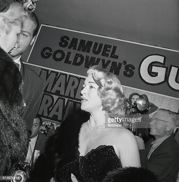 Glamour queen Lana Turner is caught by Cleo Moore's alert camera