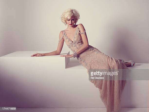 glamourous blonde woman with vintage dress