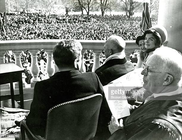 Glances are exchanged by President John F Kennedy and his wife as they sit at the Capitol during inaugural ceremony With them are former President...