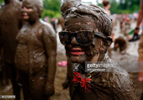 AJ Glander of Westland Michigan waits for the Mud Day King judging during Wayne County's annual Mud Day at Nankin Mills Park on July 11 2017 in...