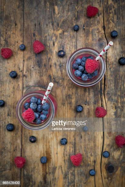 Glases of berry smoothie with blueberries and raspberries