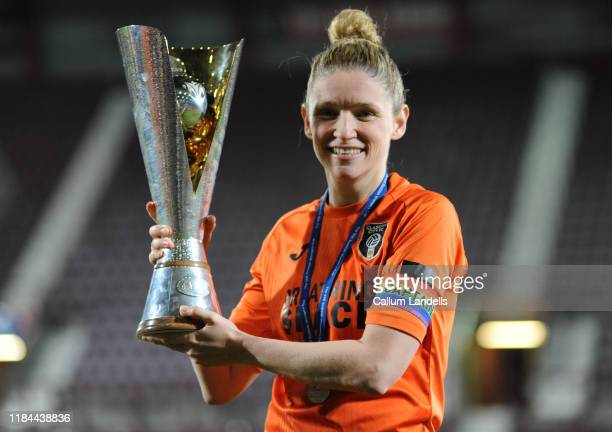 Glasgow captain Leanne Ross celebrates with the cup after the SSE Scottish women's cup final at Tynecastle Park on November 24, 2019 in Edinburgh,...