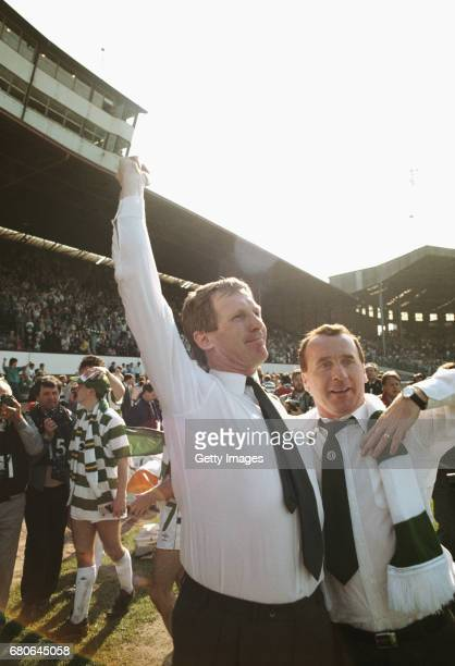 Glasgow Celtic manager Billy McNeill and assistant Tommy Craig celebrate after the 1988 Scottish Cup Final victory against Dundee United at Hampden...