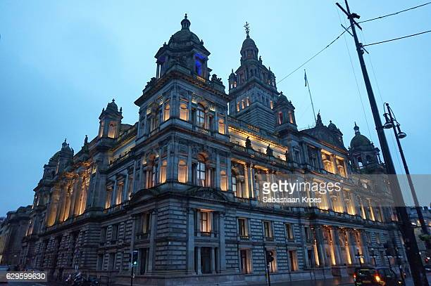 glasgow city chambers at dusk, united kingdom - george square stock photos and pictures